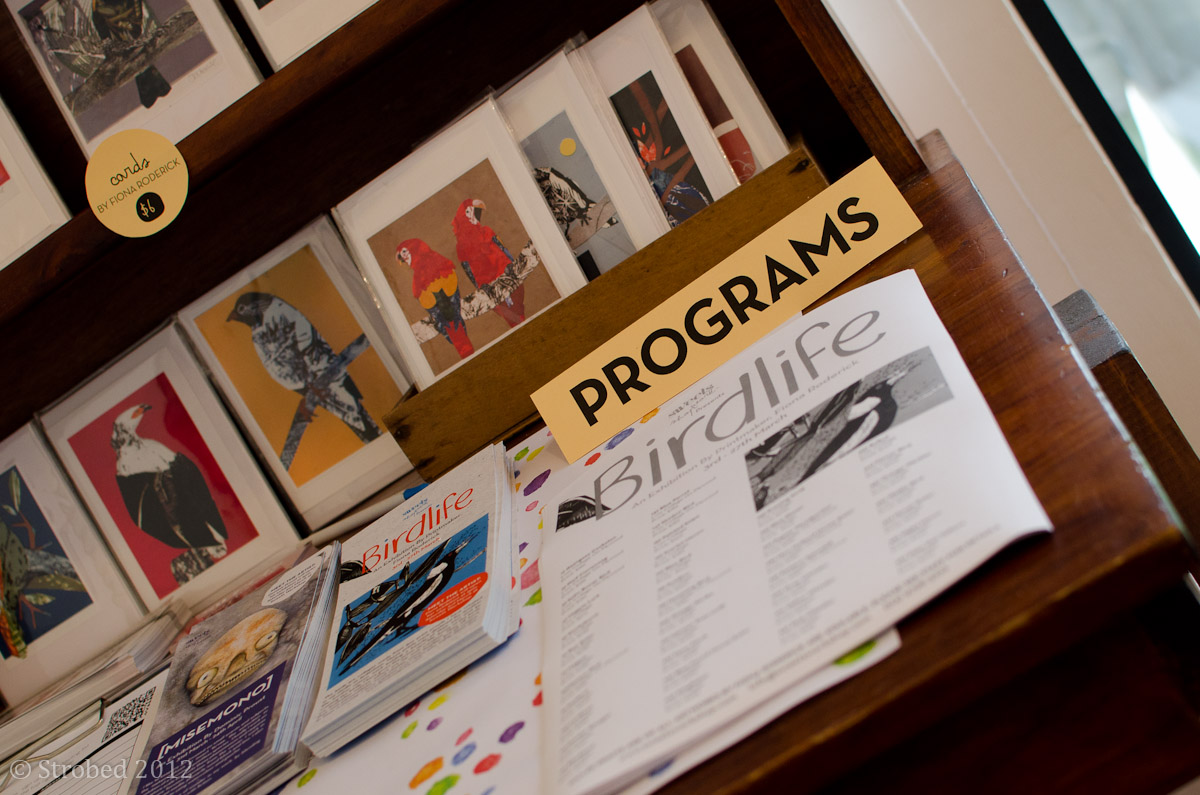 A desk with exhibition programs