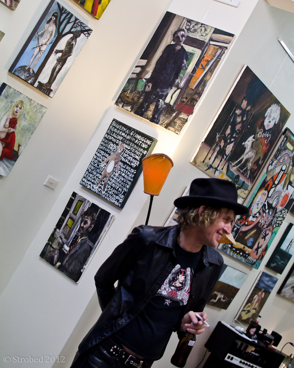 Chas Glover in front of one of his artworks